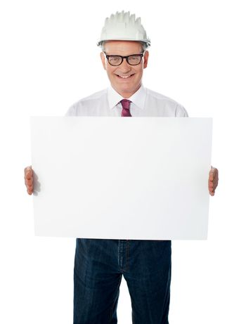 Businessman architect holding a blank white signboard
