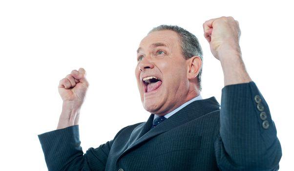 Elder businessman in a victory pose