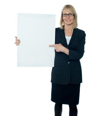 Business woman displaying placard to camera