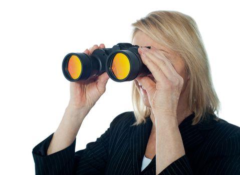 Female executive monitoring through binocular