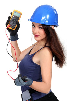 Sexy tradeswoman holding a multimeter
