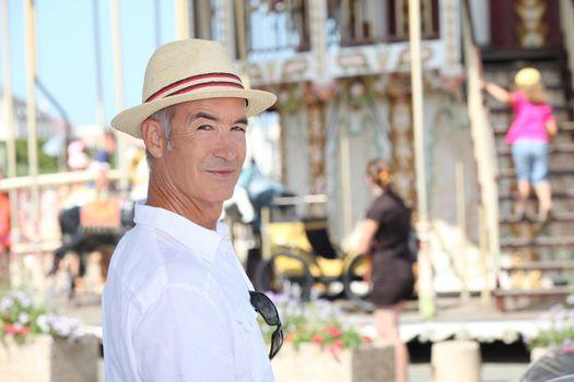 Man next to the carousel