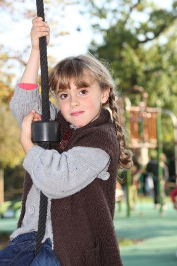 small girl in roundabout