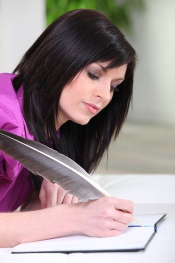 woman writing with a quill