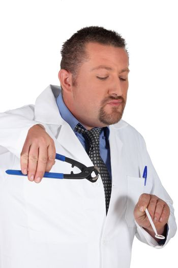 Dentist holding mirror and pliers