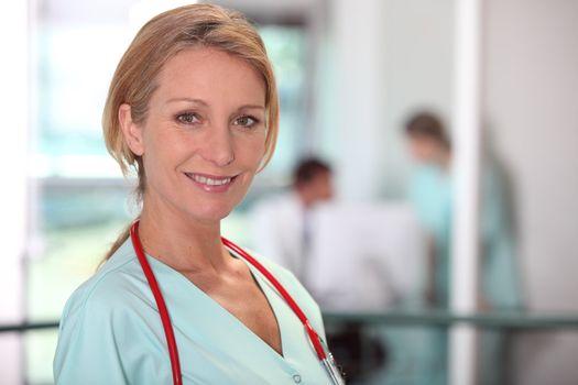 Female medic in a hospital