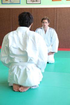 Men at the start of a judo match
