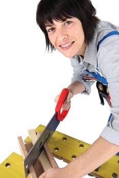 Woman sawing wood