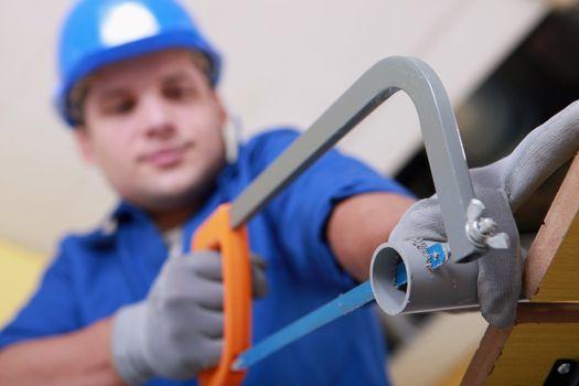 Plumbing sawing plastic pipe
