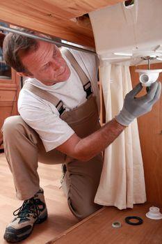 Plumber repairing faucet piping