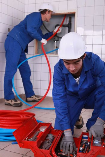 laborers installing tube