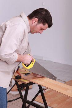 portrait of a man sawing
