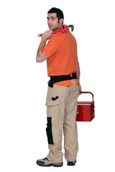 A tradesman arriving at work