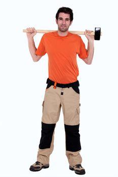 full-length portrait of carpenter holding hammer at his back
