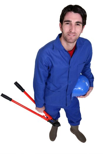 Worker wearing blue overalls