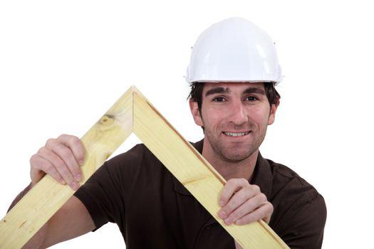 Man building wooden truss