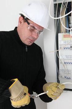 Man fixing fuse box