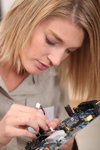 Woman with electronic component