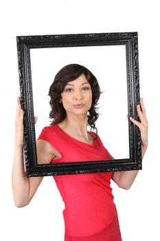 Woman framing herself