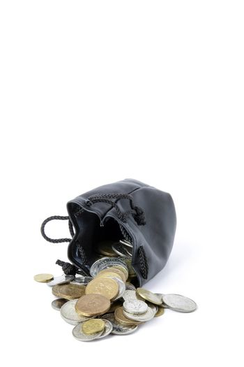 Coins spilling from purse