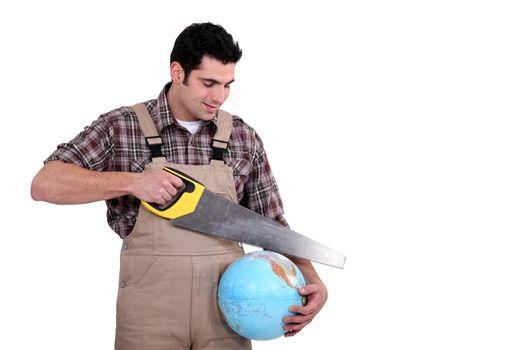 Carpenter sawing into globe