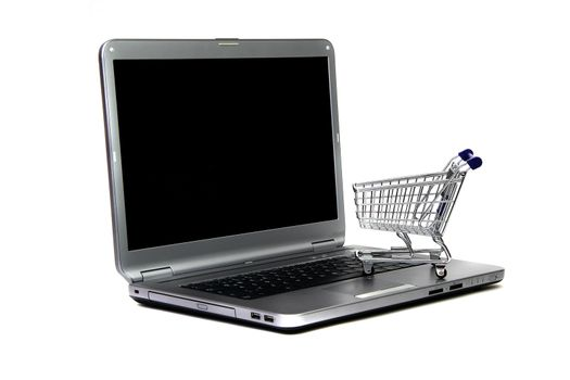 laptop and basket of commodities on white