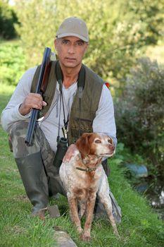 Hunter kneeling by dog