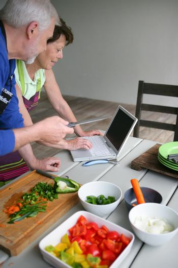 Couple looking at a recipe on-line