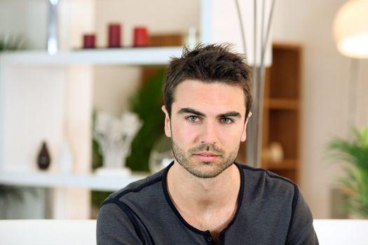 Bachelor sat on sofa
