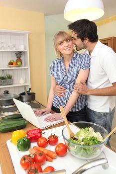 Couple following on-line recipe