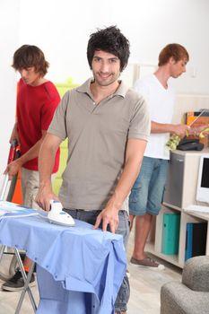 Three men doing housework