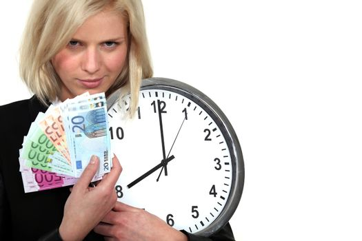 A businesswoman illustrated the concept time is money.