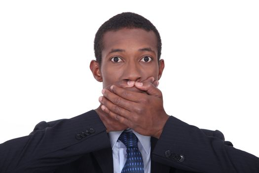 Businessman with shocked expression on face
