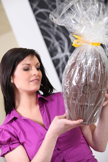 Woman with an enormous chocolate egg