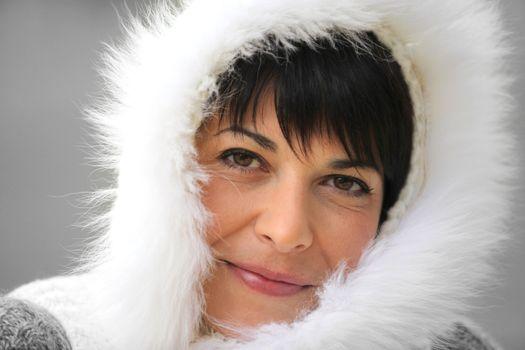 Woman wearing a fur-lined hood