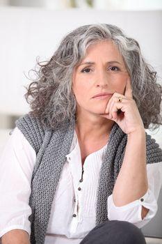 Senior woman with long grey hair