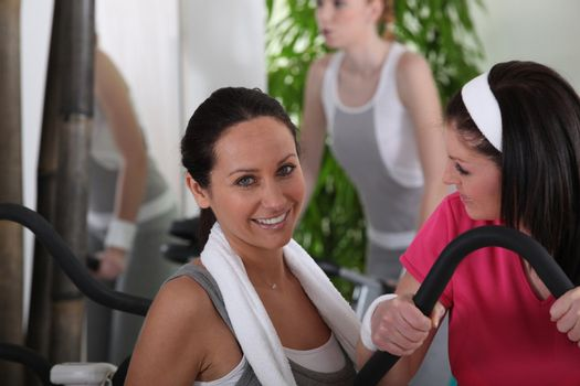 women discussing in gym club