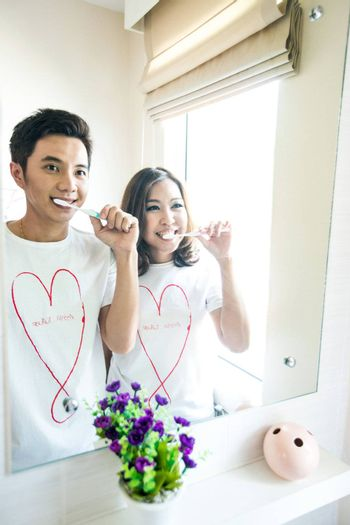 Happy smiling couple with toothbrushes