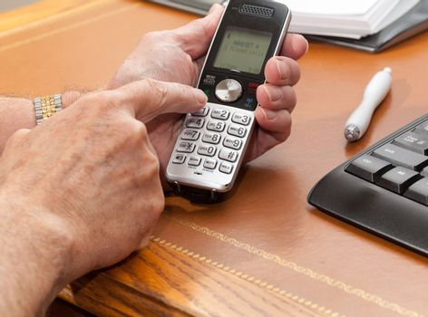 Man dialing from wireless phone