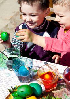 Sweet little boys fighting easter eggs