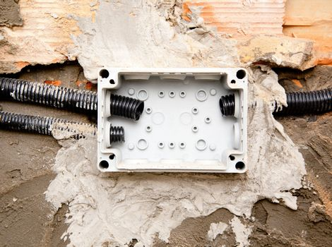 electrical coil conduit pipe on box embedded in wall