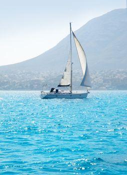 sailboats sailing in mediterranean sea