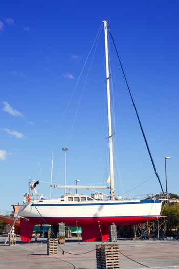 beached sailboat for the yearly hull paint