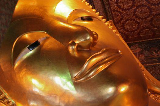Golden Buddha head close up