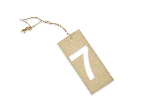 Brown paper tag with number seven cut