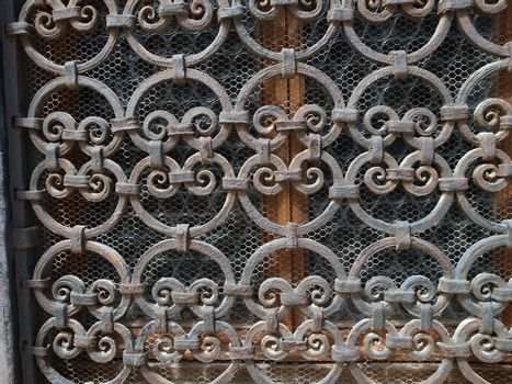 Hand made solid iron grille in the window