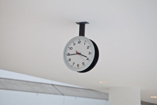 Ceiling Clock in a building corridor
