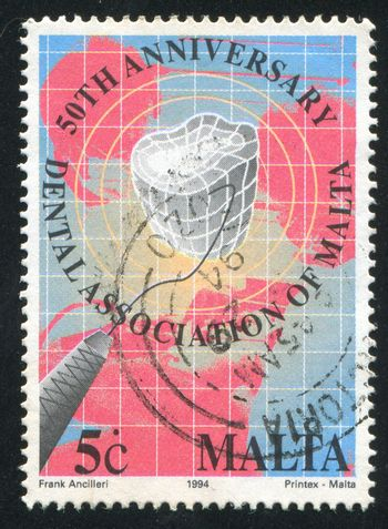 MALTA - CIRCA 1994: stamp printed by Malta, shows Dental Instrument, Tooth, Map, circa 1994