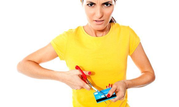 Annoyed teen customer destroying credit card