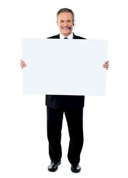 Businessman holding a blank billboard